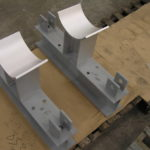 Custom pipe saddles used in trapeze style support