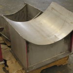Custom stainless steel pipe saddles during fabrication