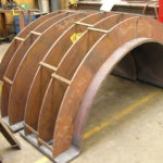 Reinforcing pipe saddles during fabrication