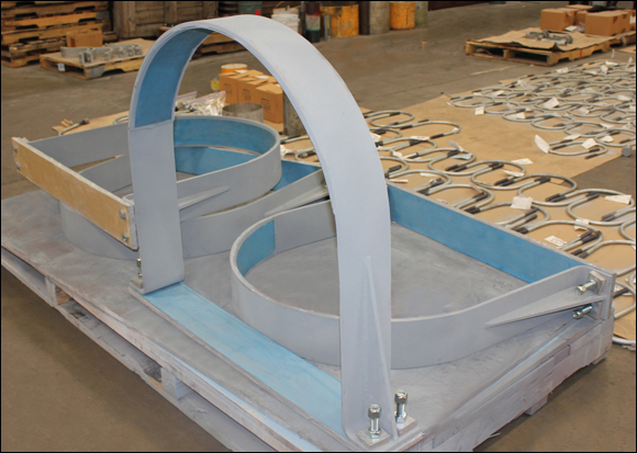 Slide Plates on Pipe Clamps for Low Coefficient of Friction
