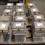 11 slide plate assemblies with marinite insulation and vibration pads