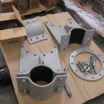 Bolted pipe saddles with custom flange attachment