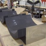 Custom pipe saddle fabricated from high density polyeurthane foam