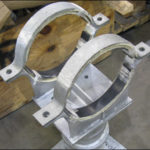 Custom elevated pipe shoe clamps designed for a 12 diameter transfer line in a polymer plant