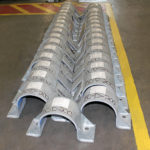 Hold-Down Pipe Clamps with Slide Plates for LNG Service